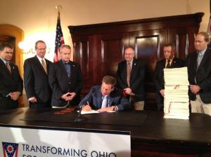 Seven men are in this photo. It's of John Kasich signing of a series of laws that fire a salvo at vulnerable women. This is the biggest escalation in the conservatives' war on women yet.