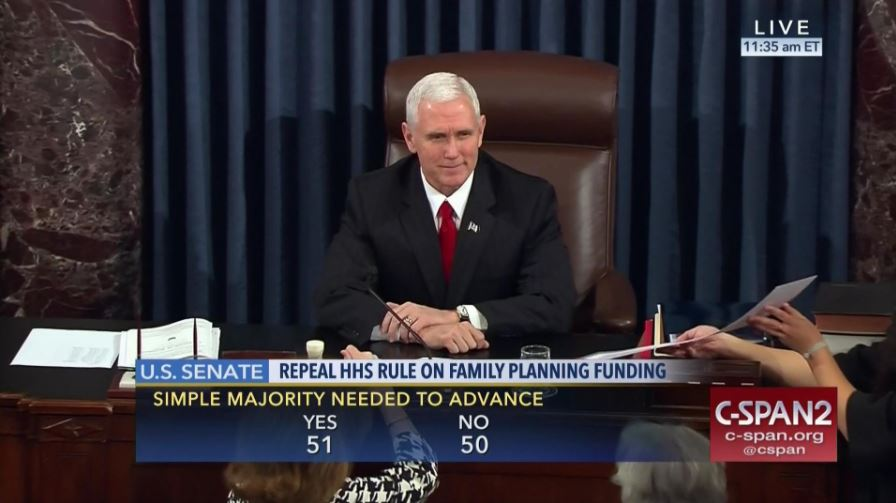 mike pence smiles as he breaks tie to destroy women's rights